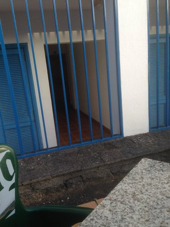 Costa Volcan Apartments: Room 304 from bar, entrance door is behind iron bars, bedroom window is on right