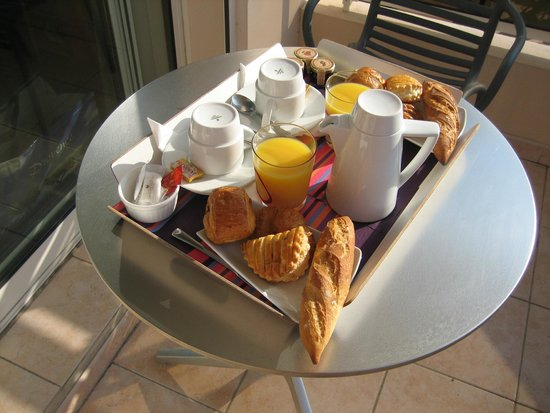 Hotel Riva: in-room breakfast served on the private balcony
