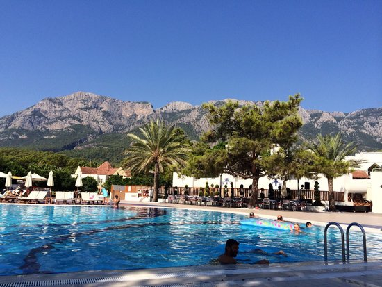 Club Med Palmiye : Village pool with mountains beyond