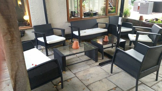 Watersmeet Hotel & Angling Centre: One of the outside seating areas