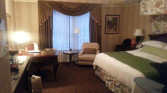 The Talbott Hotel: desk, wet bar, & bed