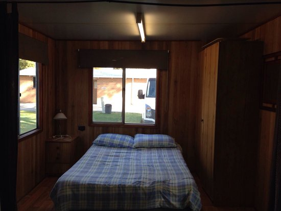 RAC Cervantes Holiday Park : cabin - double bed, bedside table, cupboard. also has curtains for privacy.
