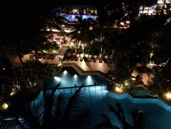 Novotel Phuket Kata Avista Resort and Spa: The main pool at night from our 5th floor club suite