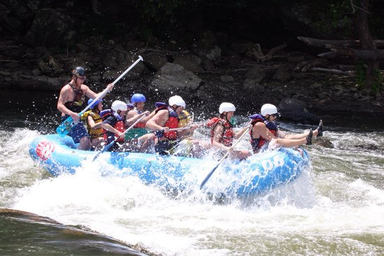 River and Earth Adventures, Inc: Riding the bull while Lucas plays the paddle guitar