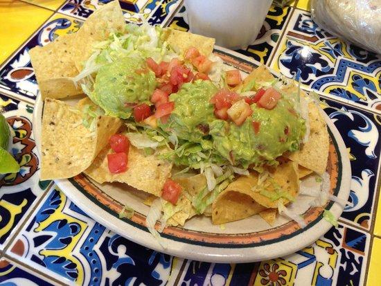 Rosa's Cafe and Tortilla Factory: The fajita combo platter includes three scoops of guacamole.