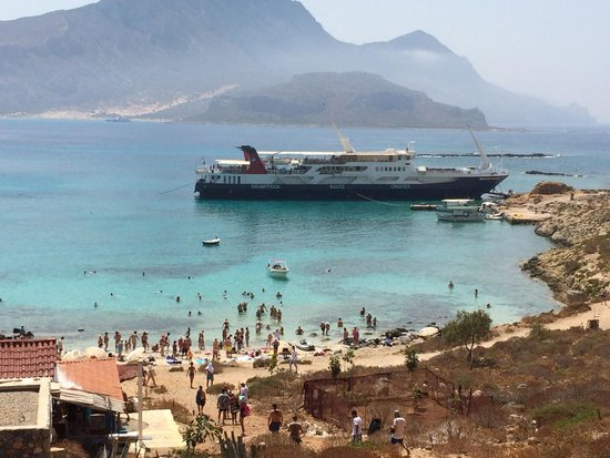 Cretan Daily Cruises : The beach filling up as we ascend.