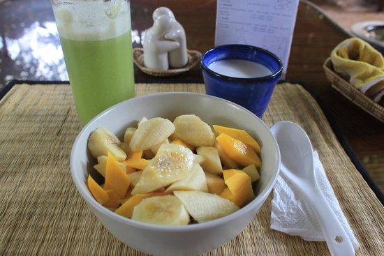 Peace Cafe : Vegan Breakfast! Cucumber juice & muesli with fruit and coconut milk :)