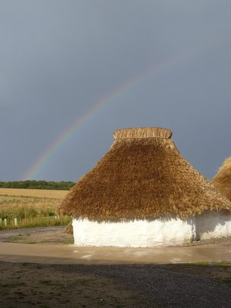 Stonehenge: Neolithic houses under a rainbow