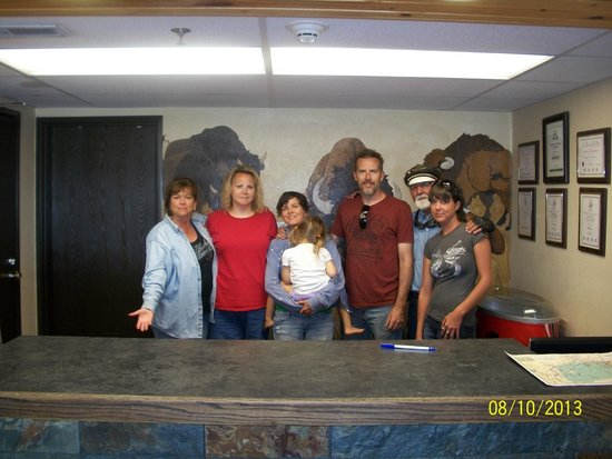 Americas Best Value Inn : Manager Reeva and our family at Reception Desk