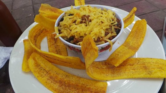 The Point Sports Bar & Grill: My dad ordered chili with chedder cheese and plaintain chips! YUM!