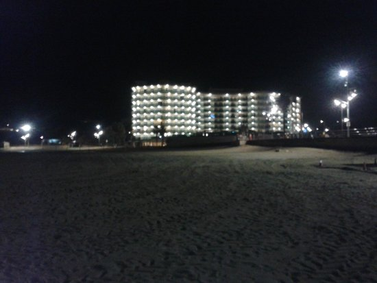 Golden Donaire Beach Hotel: View from the beach (nighttime)