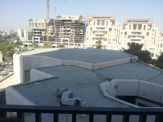 "Crowne Plaza Hotel Jerusalem: ""City view"" - means no view. The air condition in the photo was very noisy."