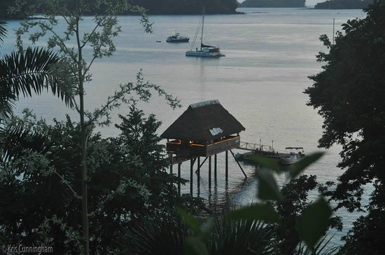 Seagull Cove Resort: As it gets dark, the lights from the tiki bar become visible.