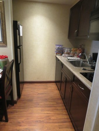 Homewood Suites by Hilton Las Vegas Airport: kitchen with microwave, stove and large fridge