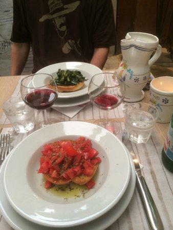 Osteria del Caffè Italiano: Friselle bread with tomatoes, oregano and oil. Very good!!