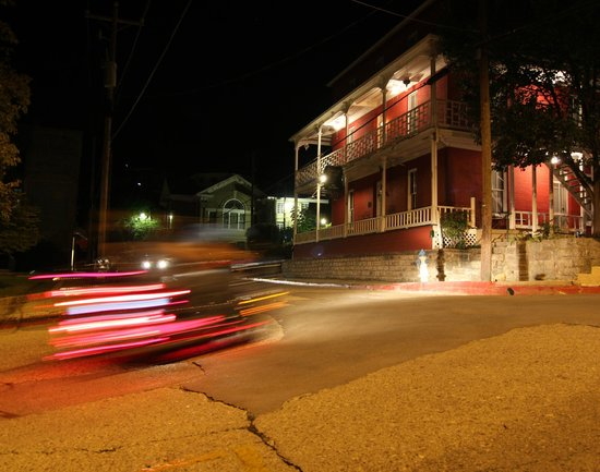 Elmwood House: Interesting vehicles pass along Spring Street in the early evening.