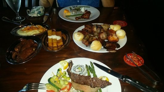Rioz Brazilian Steakhouse: variety of meats, vegetables, and wine