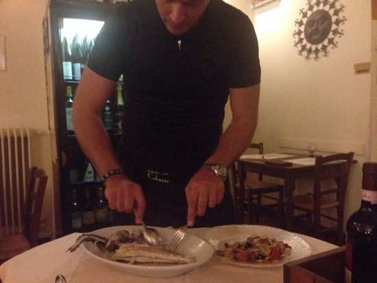 Trattoria Osteria Da Que' Ganzi : My husband having his big fish cleaned and prepared for him