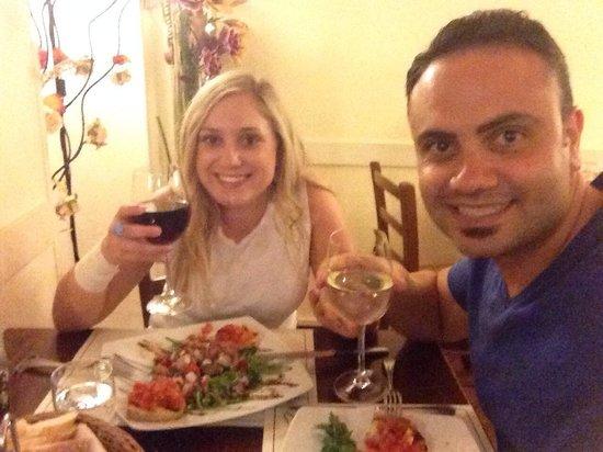 Trattoria Osteria Da Que' Ganzi : Enjoying our appetizers with a glass of wine