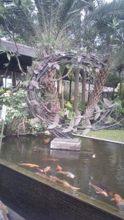 Padma Resort Legian: Koi fish pond with Art work