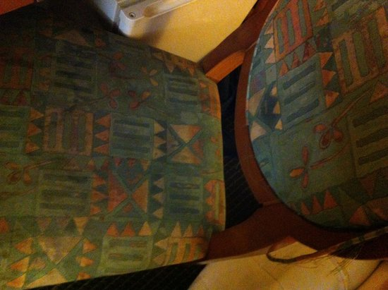 """Vagabond Inn Fresno: Stained torn up chair in my """"deluxe king"""" room"""