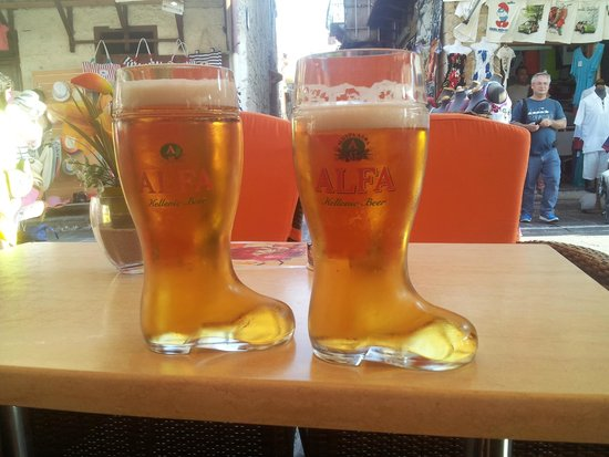 Sintrivani Restaurant: expensive beer in the long boots - with this price you can even buy the boots!!!