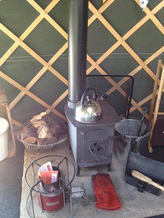 Bivouac at Druid's Temple: Log burner inside the yurt