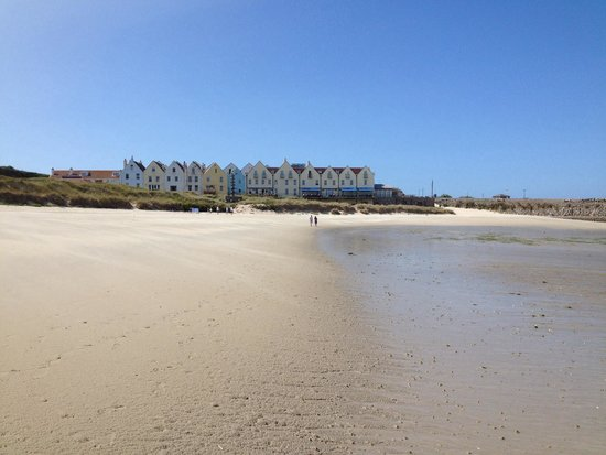 Braye Beach Hotel: A view of the hotel from Braye Beach taken mid August 2014