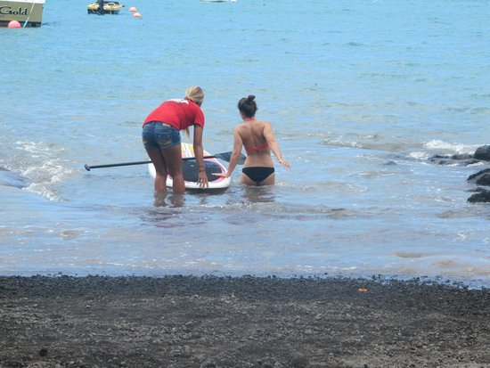 Ocean Safaris Kayak Adventures: Sam showing Stacy about the paddle board