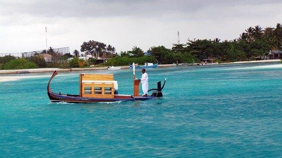 Four Seasons Resort Maldives at Kuda Huraa: Small boat to the Spa Island.