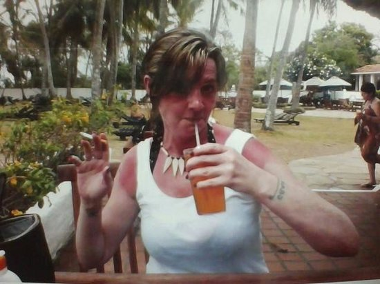 Diani Sea Lodge: The wife in enjoying her 1 of many cocktails.