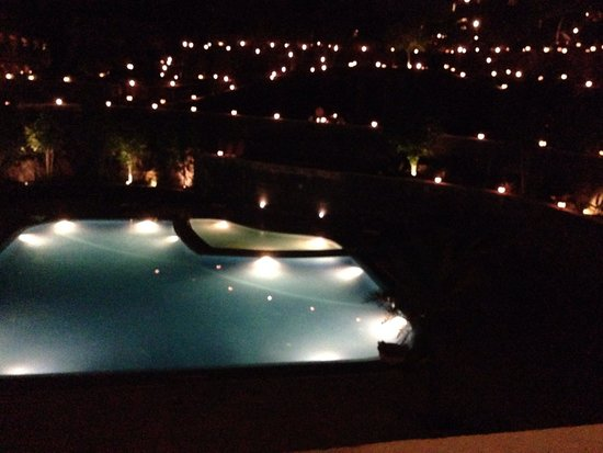 Ramada Udaipur Resort and Spa : Night view of swimming pool