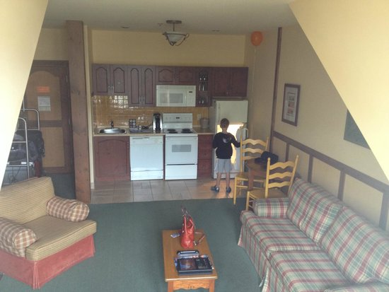 Tour des Voyageurs: Kitchen with my son looking for goodies