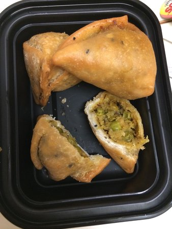 Thali: Lunch menu vegetable samosas. I cut into one for the photo
