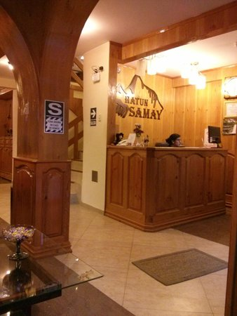 Hatun Samay: receptionist desk with staircase leading up to guest rooms (no elevators)