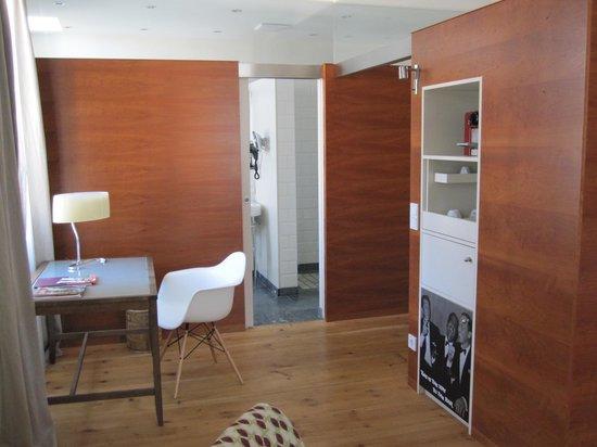 Hotel&Villa Auersperg: Desk area with bathroon in background
