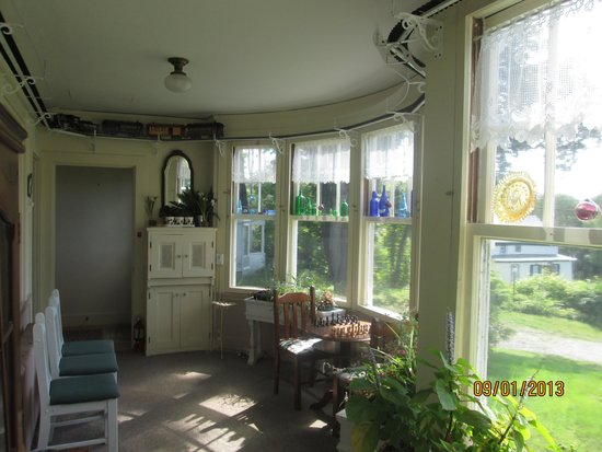 The Brewster Inn : Room connecting house with guestrooms.  A train runs along the ceiling, you can play a game or j