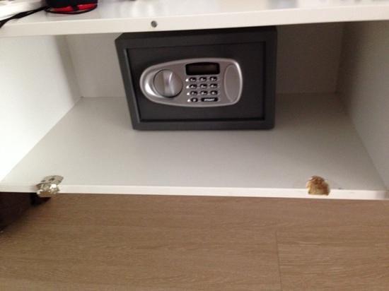 Concept Living München: broken door in the luxury room exposing the locked safe