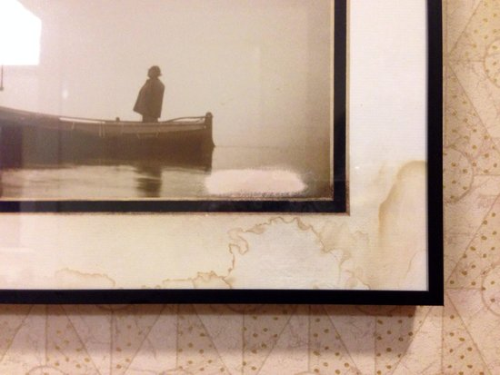 Residence Inn Moline Quad Cities: Water damage/stains on artwork in bathroom.