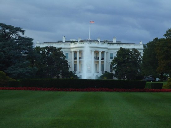The White House with the national flag flying in its glory.