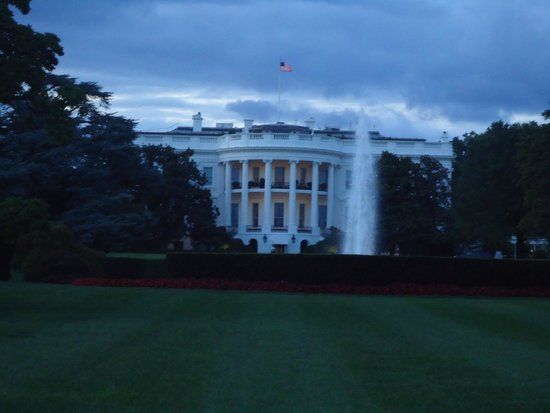 As evening sets in, the White House changes colors.