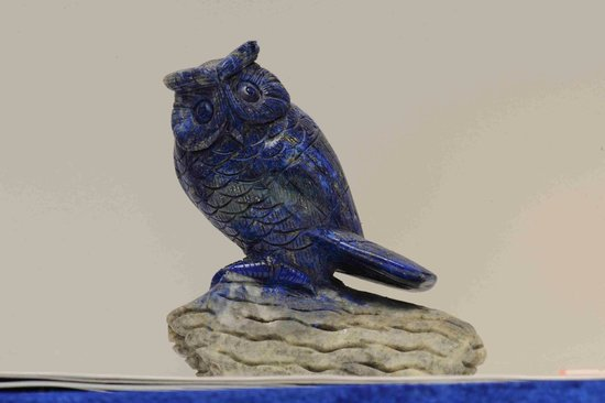Woodsies Gem Shop: An intricate carving of an owl. Lapis lazui.