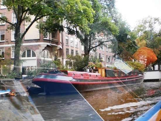 Amsterdam Canal Cruises: a boat house in the water