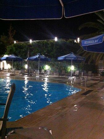 Messinian Bay Hotel: pool by night 1