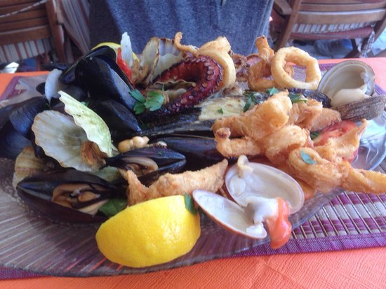 Mama Sofia's: Seafood platter for one - loads on here you can't see - large prawns, whole sea bass, calamari,