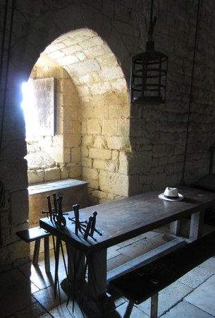 Château de Beynac : 14th century dining table with convenient slots for swords