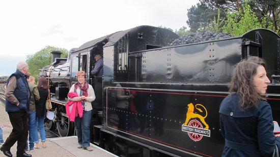Strathspey Steam Railway: Visitors examine the old steam engine of the Strathspey Railway