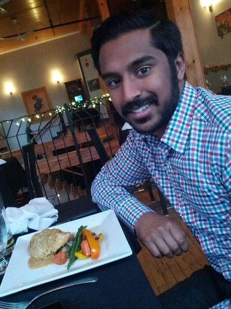 Cathedral Street Bistro : My boyfriend enjoying his chicken dish