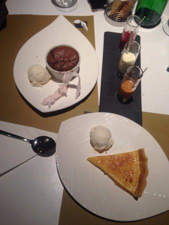Olive Street: Salted chocolate soufflé!  Lemon tart with mastiha ice cream..! The desert was complimentary fr