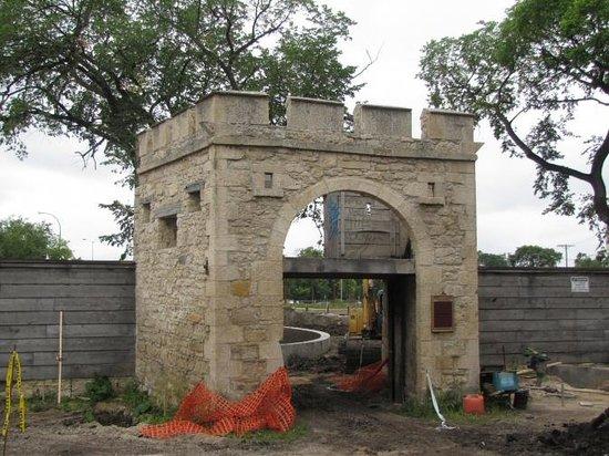 Super 8 Winnipeg East MB: Historic gate at Upper Fort Garry.  Landscaping in progress.